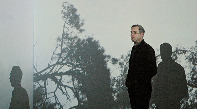 Richard Garet in front of the installation Bioderivas 'Observatory Movement I', video by Yapci Ramos